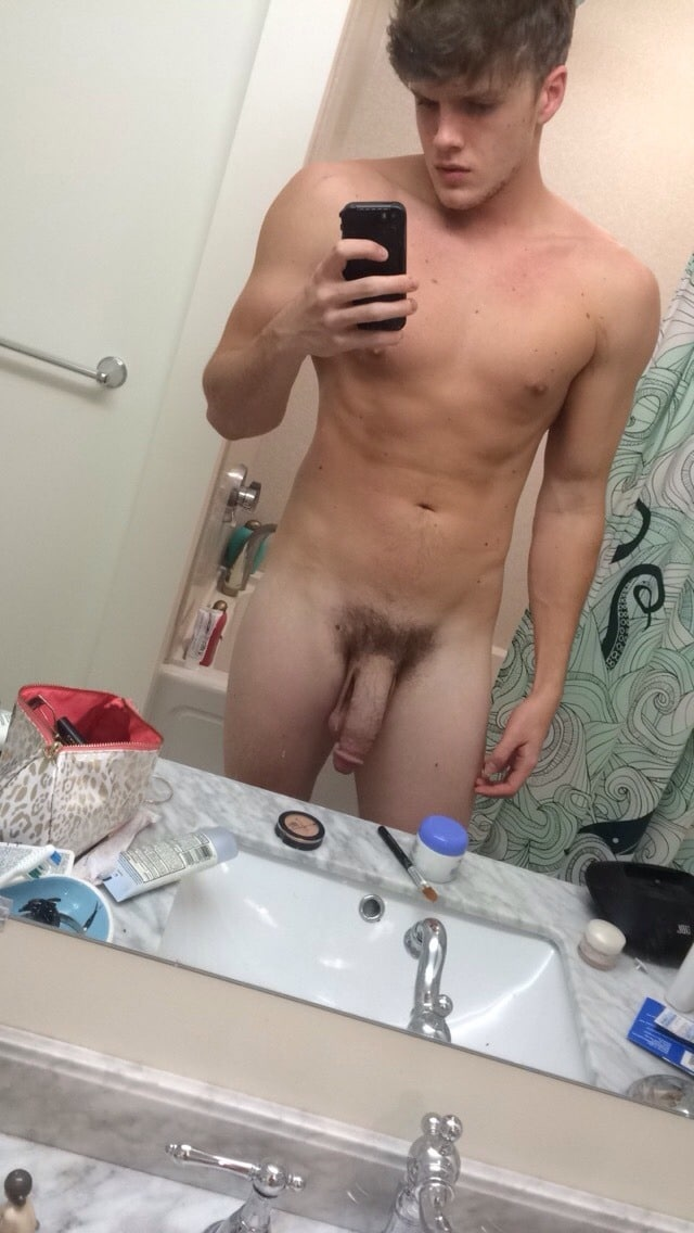 Hung nude boy taking a mirror selfie