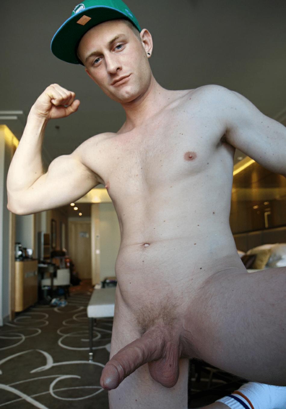 Nude boy flexing